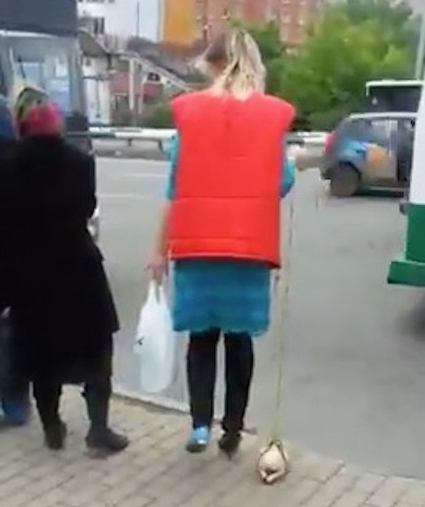 Woman-takes-chicken-for-a-walk-1